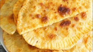 Чебуреки в духовке из пресного теста под сыром
